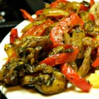 Spicy Pepper and Onion - This sauteed mixture of sweet onion, bell pepper, mushrooms, and garlic in a spicy and tangy sauce is great with grilled steak.