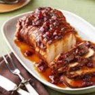 Slow Cooker Pork Roast - This simple pork roast is first rubbed with onion soup mix, covered in cranberry sauce, then slow-cooked to tender perfection in this sweet and savory twist on the traditional pork roast.