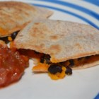 Tina's Halloween Quesadillas  - Before you send your little ghouls out the door on Halloween, feed them a warm supper of orange-colored tomato tortilla quesadillas, filled with Cheddar cheese, sweet potatoes, and black beans. You can cook the sweet potatoes in a microwave oven ahead of time.