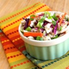 Tangy Southwest Coleslaw - A coleslaw adapted to the South Beach diet that replaces the typical mayonnaise-based dressing with cumin-scented lime juice sweetened with no calorie sweetener.