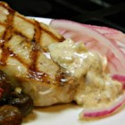 Pork Chops with Sweet Mustard Sauce - Red onion slices soaked in cider vinegar top these pan-fried pork chops. The recipe also features a creamy apricot-mustard sauce for dipping.