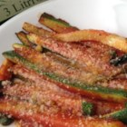 Zucchini Parmesan with Tomato Sauce - Zucchini Parmesan, similar to eggplant Parmesan, includes sauteed zucchini in tomato sauce that can be served alongside chicken or fish.