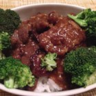 Crispy Orange Beef - A delicious crispy and sweet, yet  mildly spiced beef stir-fry recipe served with steamed rice and broccoli.