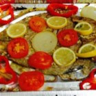 Salvadorian Baked Fish - White fish seasoned with garlic and lime juice is baked under a layer of sliced vegetables for a simple and tasty Salvadorian entree.