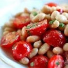 Tomatoes and Beans - Canned white beans are simmered with tomatoes in a garlicky broth-based sauce in this quick and easy side dish recipe.