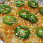 Cheesy Jalapeno Dip - This cheesy and creamy baked dip recipe uses canned and fresh jalapeno peppers to bring the heat for an item that can double as an ideal bacon-cheeseburger spread.