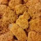 Gluten-Free Chicken Nuggets - These homemade chicken nuggets are breaded with rice flour and corn cereal for a gluten-free option of a kids favorite.