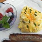 Cheesy Oven Scrambled Eggs - This big brunch recipe delivers a big pan of cheesy scrambled eggs with plenty of hot sauce and seasoned salt for flavor.