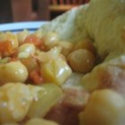 Indian Chickpeas - Garbanzo beans, onions, and spices are simmered together in this typical Northern Indian recipe that is easy to make, and delicious.  You will need to go to an Indian grocery to buy the masalas.