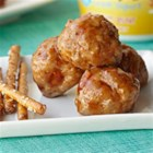Barbecue Turkey Meatballs - VOSKOS(R) Nonfat Honey Greek Yogurt adds a hint of sweet to these lean meatballs dressed up with marmalade barbecue sauce. For easy shaping, use a small scoop to form the meatballs, then bake them off in the oven. To party with ease, transfer meatballs and sauce to a slow cooker set on warm or low heat setting to serve. Serve with crunchy pretzel sticks as a fun substitute for wooden picks.