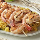 Shrimp with Fruited Couscous - This easy shrimp changes expectations on recipes worthy of backyard barbecues. An herb-yogurt-balsamic marinade brings a pop of tangy flavor to the skewered seafood. Serve on a bed of so-simple couscous dotted with orange peel and dried cherries.