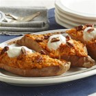 Twice-Baked Sweet Potatoes from VOSKOS(R) - The comforting aroma of cinnamon spice twice-baked sweet potatoes for a new twist on a family favorite. For a finishing touch, spoon on a fresh topping that mixes VOSKOS(R) Honey Greek Yogurt with zesty orange juice and peel. A sprinkle of toasted pecans adds just the right crunch.