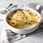 Scalloped Potatoes with Bacon and Sun-Dried Tomatoes - Looking for an easy creamy scalloped potato recipe? Well, this is it. Accented with bacon and sun-dried tomatoes, you can't go wrong.