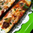 Grilled Zucchini Pizza with Goat Cheese - Zucchini slices become the pizza crust in this delicious grilled treat.