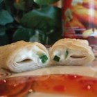 Jalapeno Popper Wontons - A simple Asian twist on jalapeno poppers served with sweet chili sauce.