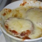 Southern Style French Onion Soup - In this easy to prepare recipe, an onion sauteed in butter and thyme is combined with white wine and beef broth.   Serve in individual portions topped with a baguette slice and melted mozzarella cheese.