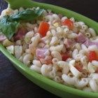 Macaroni, Pineapple, and Ham Salad - This mixture of macaroni, pineapple, ham, eggs, tomatoes, and onion is dressed with Italian-style salad dressing.
