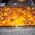 Tamale Casserole - Canned beef tamales are cut into chunks and combined in a casserole with onion, cheese, tortilla chips and (beanless) chili. These are baked for 40 to 45 minutes.