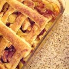 Apple Lattice Fruit Bake - This warm apple dessert topped with flaky puff pastry strips invokes a feeling of home and tastes great with vanilla ice cream.