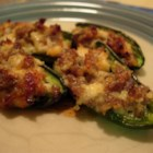Sausage Stuffed Jalapenos - Jalapeno pepper halves are stuffed with cheese and sausage. You will love this spicy appetizer treat!