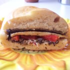 Eggplant and Pepper Parmesan Sandwiches - Smoky grilled veggies, rich tapenade, and tangy goat cheese make these sandwiches hearty and satisfying. A friend of mine made these and I loved them. By the next week, I was craving one of these delicious sandwiches.