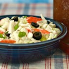 Summertime Crab Slaw with Napa Cabbage - Salads are a summertime staple. This recipe mixes cabbage, crab, celery, radish, and olives, and goes well with your favorite vinaigrette.