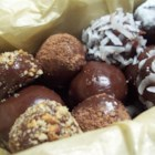 Brigadeiro - Cocoa, butter and condensed milk are cooked, allowed to cool and formed into little balls for easy eating.
