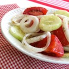 Marinated Cucumber, Onion, and Tomato Salad - Summertime is the right time for cucumber and tomato salad. This one is dressed with a basic homemade salad dressing.