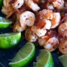 Garlic Lime Bacon-Wrapped Shrimp - This is a quick and easy appetizer or main dish focusing on a garlic lime marinade and thick slices of peppered bacon wrapped around green chilies and shrimp. This recipe works exceptionally well on an indoor grill.