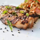 Sesame Grilled Salmon - Grilled salmon flavored with a soy sauce-based marinade and sprinkled with sesame seeds is a quick and easy meal.