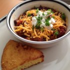 Spicy Slow-Cooked Chili - Hearty and spicy chili made in the slow cooker. Chili powder and cayenne pepper give it a kick, while plenty of ground beef and kidney beans make for a filling and satisfying meal.
