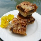 Mona's English Toffee Cookie Bars - English toffee cookie bars layered with chocolate, almonds, and sweetened condensed milk are easy to prepare and will be gone in minutes!