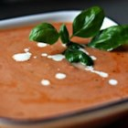 Rich and Creamy Tomato Basil Soup - Cooked tomatoes and tomato juice are pureed with fresh basil leaves in this soup thickened with heavy cream.
