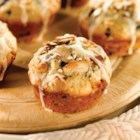 Blueberry White Chocolate Macadamia Muffins - These quick blueberry muffins with white chocolate chips and macadamia nuts are drizzled with more white chocolate for a delicious snack.