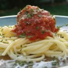 Spaghetti With Marinara Sauce - You'll find many uses for this versatile pasta sauce. Let tomatoes, garlic, sugar, parsley, garlic powder, oregano and basil go for a nice, slow simmer with zesty jolt of flavor from capers and crushed red pepper.