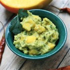 Mango Chipotle Guacamole - With a smoky twist on traditional guacamole, this dip gets a kick from chipotle powder and sweet notes from mango. It's excellent with chips or paired with carne asada or carnitas.