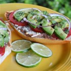 Molletes with Deconstructed Guacamole - Open-faced refried bean and cheese sandwiches, topped with tomatoes, fresh avocados from Mexico, red onion and cilantro. My own twist on this Mexican comfort food!