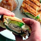 Turkey and Avocado Panini - Pressed between warm slices of bread and dressed with honey Dijon, this combination of oven-roasted deli turkey, creamy ripe avocado, crumbled goat cheese and baby spinach melts together for delicious flavor and texture.
