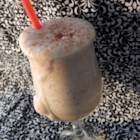 Frozen Irish Cream - Frozen Irish cream coffee drink includes Irish cream liqueur, coffee, and ice blended together for a creamy adult-only beverage.
