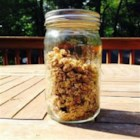 Easiest Peanut Butter Granola Ever - Make your own peanut butter-flavored granola using just oats, raisins, cinnamon, honey, egg white, peanut butter, and this easy DIY recipe.