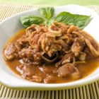 Calamari in Red Wine and Tomato Sauce - Serve this delicious dish as an appetizer with crusty bread, or as a main dish over pasta.