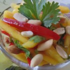 Easy Mango Salad - This Thai-style salad features firm mango, onion, and bell pepper in a homemade dressing with lime juice and fish sauce.