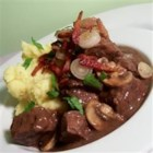 Beef Bourguignon III - This easy recipe is a firm favorite in my family for years now. Cubes of beef are simmered in a red wine gravy, and served with a garnish of sauteed onions and mushrooms.