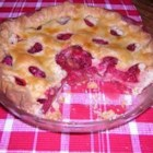 Raspberry Pie II -  Just over two cups of raspberries are heaped into a pie crust, sprinkled with lots of brown sugar and a bit of cornstarch for thickening, and dotted with butter. The top crust goes on, and then this luscious pie is slipped into a hot oven to bake.