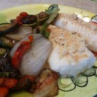 Cod with Lemon, Garlic, and Chives - Simple baked foil pouches contain a fillet of cod, fresh lemon slices, garlic, and chopped chives for a flavor combination that enhances the taste of the fresh fish.