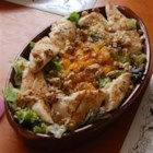 Warm and Limey Chicken Salad - Marinated boneless chicken breast strips are placed on a bed of lettuce with mandarin oranges, walnuts, and golden raisins, then dressed in a tangy lime dressing.