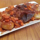 Slow Cooker Sweet-and-Sour Pot Roast - Tomato sauce, vinegar, and brown sugar make a sweet-and-sour sauce in which beef roast and vegetables cook slowly for a luscious dinner entree.