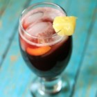 Sassy Sangria - Red wine with pineapple, orange, lime and sugar in sweet punch.