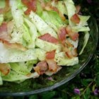 Fried Cabbage II - Cabbage and onions are sauteed in bacon grease, and served with a splash of vinegar, for a tangy, hearty dish that will surprise you.