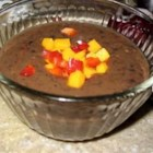 Calypso Black Bean Soup - Black bean soup sizzles in this spicy, Caribbean-inspired version combining mangoes and bananas with onions, garlic, coconut milk, hot pepper sauce, cumin, and ginger.